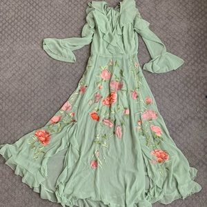 Sage green dress with floral embroidery